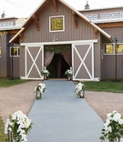 Aspen Colorado wedding reception barn wedding venue lantern orchid greenery decor outside