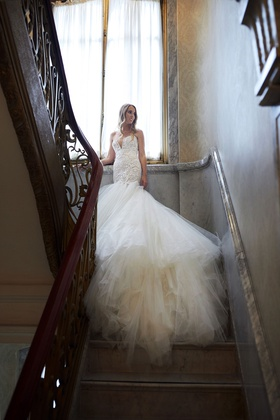 bride in galia lahav wedding dress from bridal reflections drop waist trumpet gown tulle skirt long