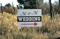Directional sign for ranch wedding with heart arrow