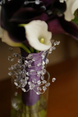 Calla lilies tied with purple ribbon and crystals
