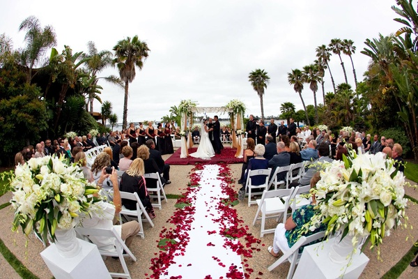 Romantic red wedding in san diego california inside weddings petal lined aisle and ivory floral arrangements junglespirit Gallery