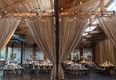 rustic elegant reception with tan drapery dividing the room