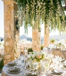 malibu rocky oaks wedding, chandeliers dripping with white flowers and greenery