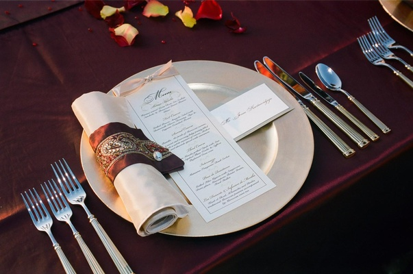 Maroon napkin ring with red and gold beads