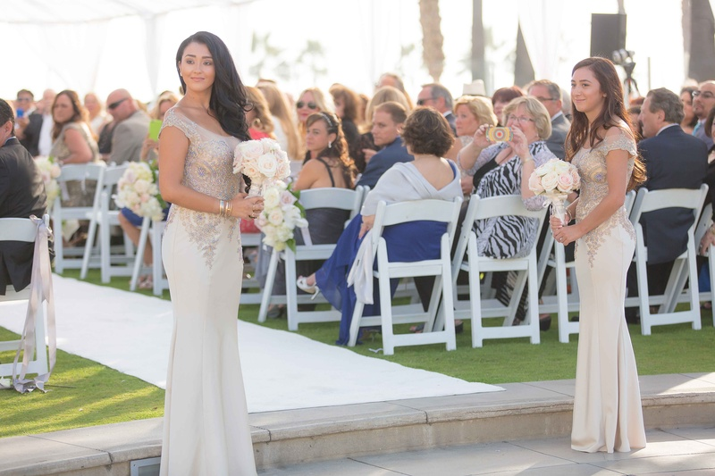 Couple's daughters waiting to walk mother and father down aisle for vow renewal wedding anniversary