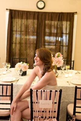 Future bride sits at bridal shower