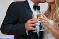 Joanna Krupa and Romain Zago kiss with wedding champagne