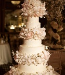 Elegant wedding cake with sugar orchids and peonies