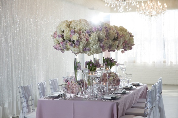 Wedding styled shoot reception inspiration white drapes crystals tall centerpiece purple linens