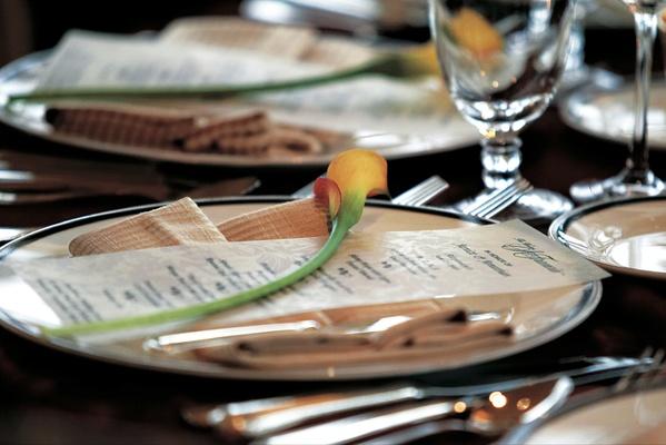 Vellum wedding menu with calla lily on top