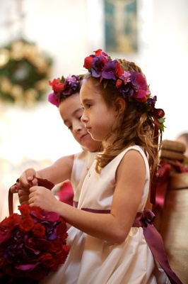 White satin flower girl dress with purple bow
