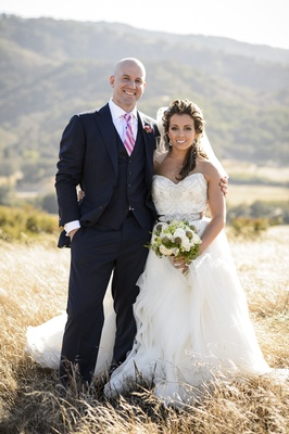 Man wearing three-piece suit and woman in wedding dress
