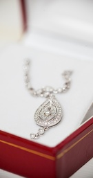 Pave diamond halo necklace in teardrop shape
