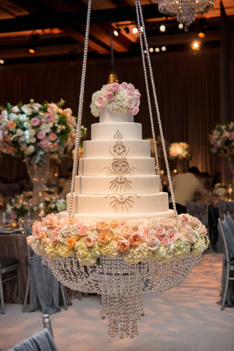 Cakes desserts photos sparkling wedding cake on swing inside wedding cake on chandelier swing with crystal rope details and fresh flowers sparkling details arubaitofo Image collections