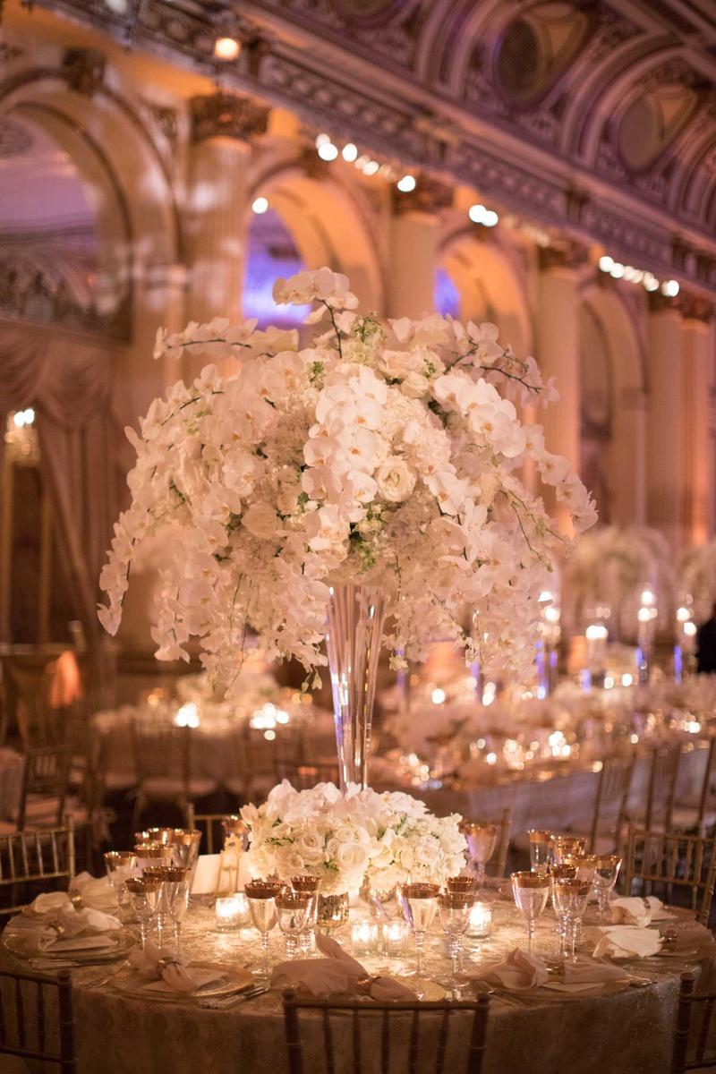 wedding reception rount table tall centerpiece orchid rose hydrangea flowers gold rim glassware