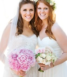 Bridesmaid wearing floral crown with roses
