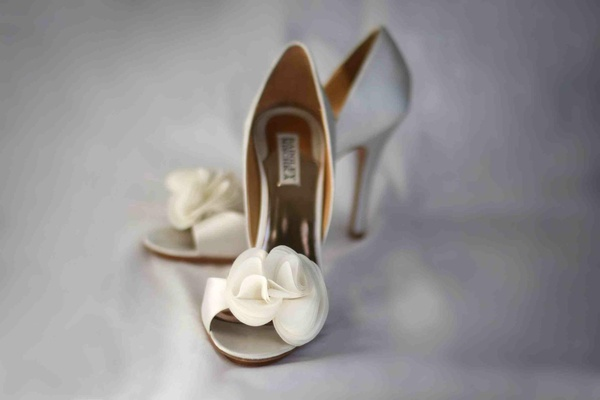 Badgley Mischka white wedding heels with flower