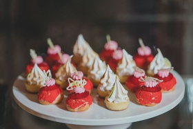 meringue desserts strawberry vanilla tarts on white tray at dessert table display wedding reception