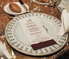 Red and white menu card on patterned plate