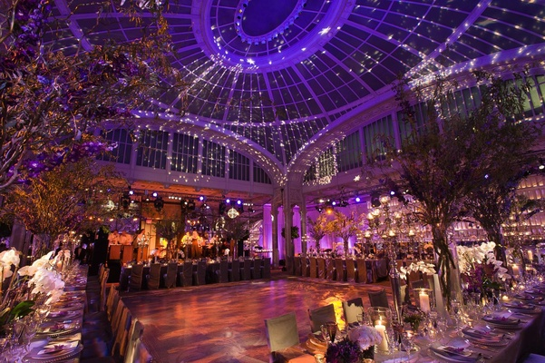Indoor wedding reception with vaulted ceiling and opulent decorations