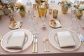 Tablescape with gilt details and orange flowers