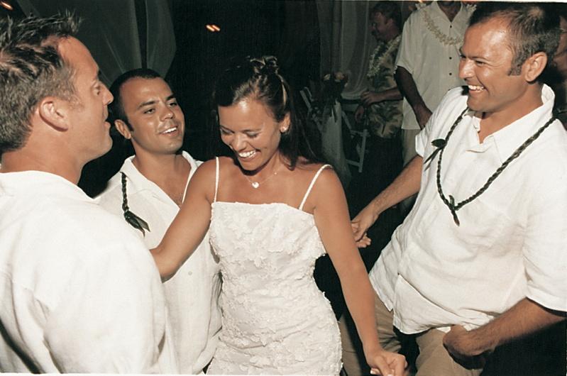 dancing guests surround bride