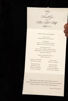 Wedding program on ivory three-fold stationery
