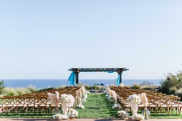 Wedding ceremony Jewish at Terranea Ranchos Palos Verdes CA bluff over ocean natural decor