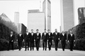 Black and white photo of groom and groomsmen walking through city of Chicago