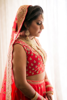 bride in lehnga indian wedding gold red attire and jewelry pretty makeup