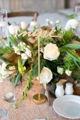 Wedding reception DeMarco Murray gold table number lasercut with low centerpiece