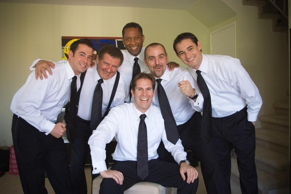 Groom with groomsmen in groom's suite