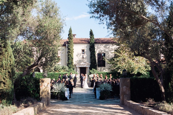 A classic wedding with rustic touches at a villa in santa barbara santa barbara wedding ceremony at mediterranean inspired venue junglespirit Image collections
