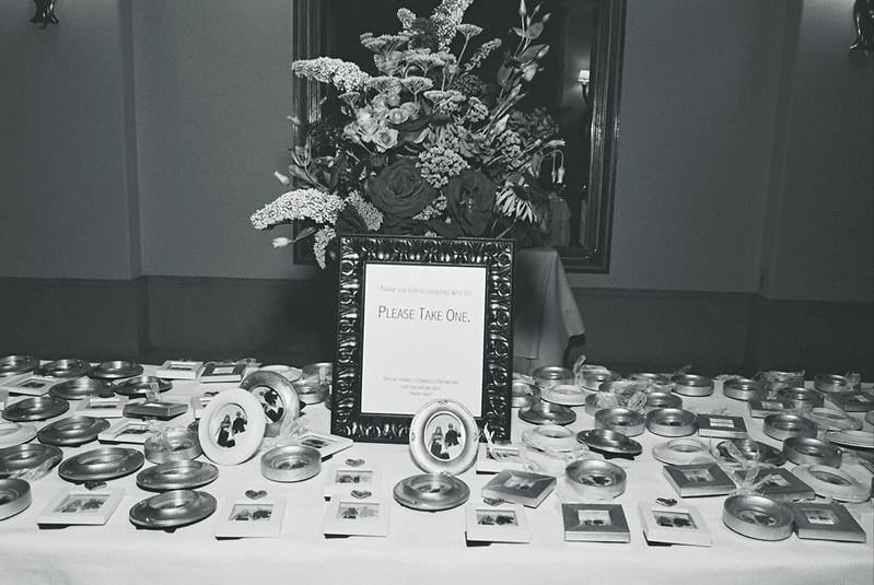 Black and white photo of wedding favors display
