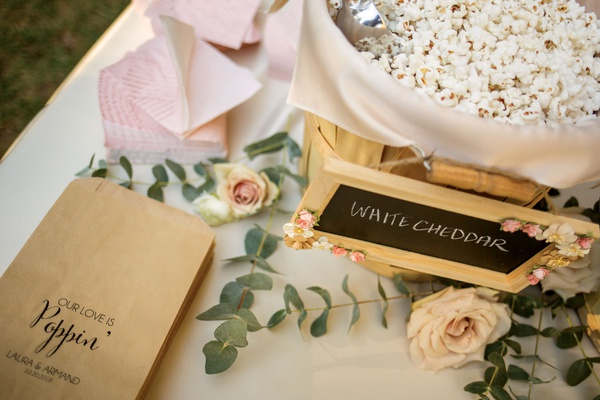 wedding ceremony flavored popcorn station with kraft paper custom bags chalkboard sign white cheddar