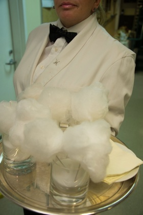 Wedding server white tuxedo jacket with silver tray of cotton candy clouds in glasses for late night
