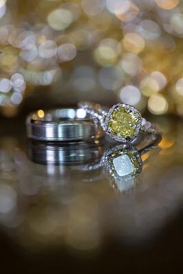 yellow diamond halo engagement ring with platinum wedding band