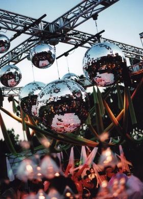 Sunset outdoor wedding reception with disco dance floor