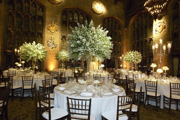 Round white tables with tree-like centerpieces