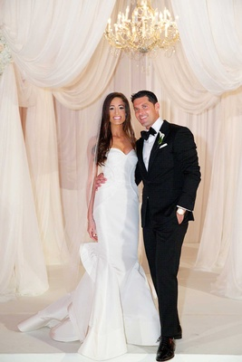 Bride in Oscar de la Renta strapless wedding dress with Chad Carroll