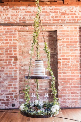 Semi Naked Cake on Tiered Display Suspended from Ceiling greenery white roses floating candles