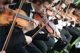 Group of people playing violin for outdoor wedding ceremony in beverly hills tuxedos strings
