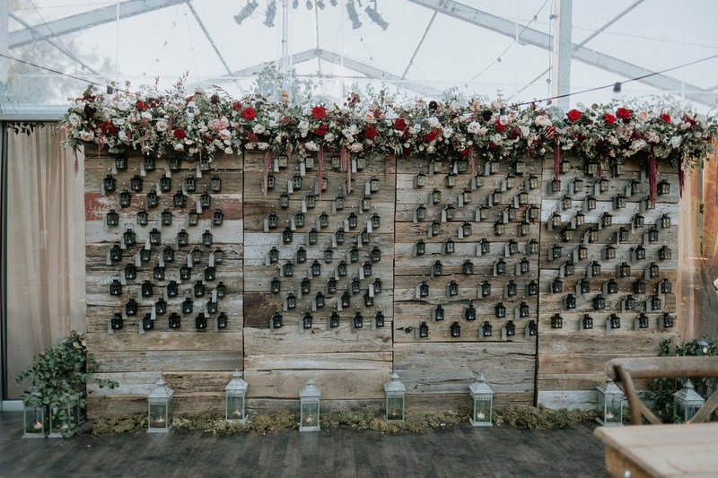 wedding reception fall wedding ideas lanterns reclaimed wood wall burgundy flowers