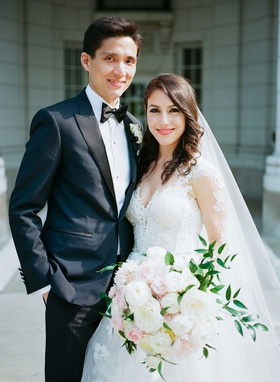 wedding portrait groom in tuxedo and bow tie bride in monique lhuillier wedding dress and veil hair