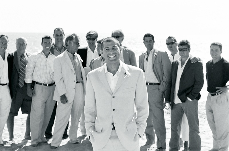 Black and white photo of groom with male guests