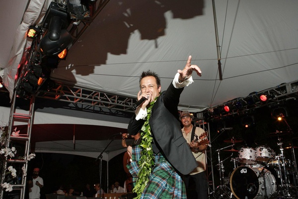 Angus Mitchell, co-owner of John Mitchell Systems, sings at his wedding reception