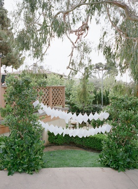 Clothesline of white hankies for escort cards at reception
