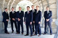 Groom and groomsmen in navy suits blue ties brown dress shoes