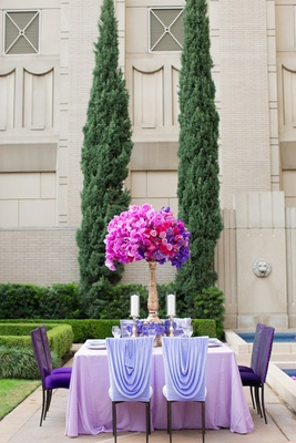 Wedding reception at The Ritz-Carlton, Dallas garden with purple linens, flowers, and fuchsia orchid