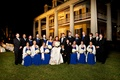 Bridesmaids in floor length royal blue dresses with groomsmen in black suits at Louisiana plantation